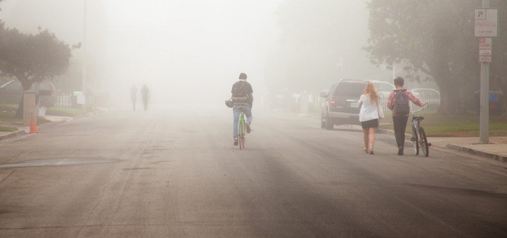 Kids going to school on a foggy morning in Newport Beach