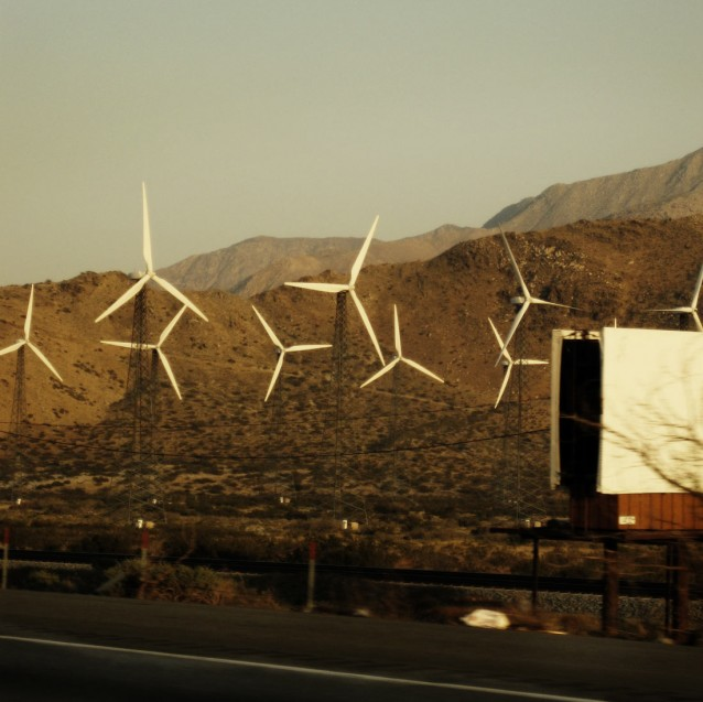 Windmills and blank sign